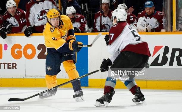 Filip Forsberg of the Nashville Predators shoots the puck against Gabriel Bourque of the Colorado Avalanche in Game Two of the Western Conference...