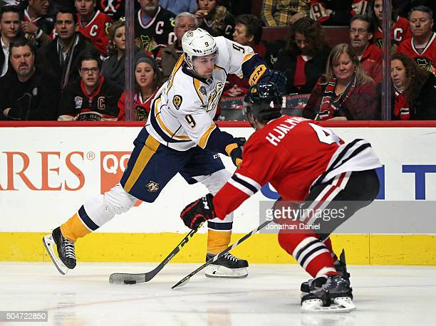 Filip Forsberg of the Nashville Predators shoots the puck past Niklas Hjalmarsson of the Chicago Blackhawks at the United Center on January 12 2016...