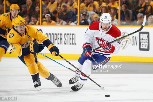 Filip Forsberg of the Nashville Predators skates against Joe Morrow of the Montreal Canadiens during an NHL game at Bridgestone Arena on November 22...
