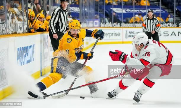 Filip Forsberg of the Nashville Predators skates against Vincent Trocheck of the Carolina Hurricanes during the second period at Bridgestone Arena on...
