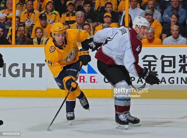 Filip Forsberg of the Nashville Predators takes a shot behind Tyson Barrie of the Colorado Avalanche during the third period of a 52 Predators...