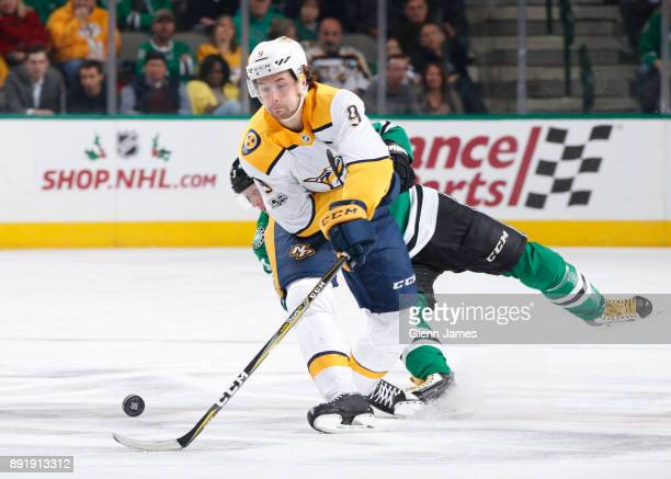 Filip Forsberg of the Nashville Predators tries to keep the puck away against the Dallas Stars at the American Airlines Center on December 5 2017 in...