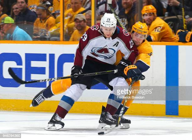 Filip Forsberg of the Nashville Predators tries to poke the puck away from Nathan MacKinnon of the Colorado Avalanche during the second period in...