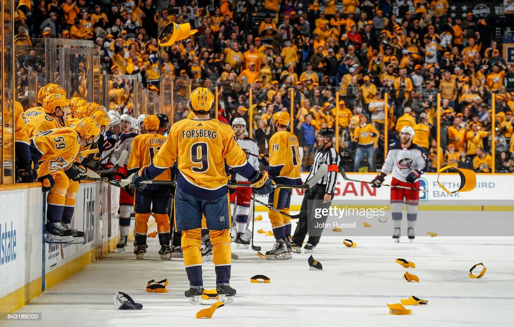 Filip Forsberg #9 of the Nashville Predators watches as hats flood the ice after his empty net hat trick goal against the Columbus Blue Jackets during an NHL game at Bridgestone Arena on April 7, 2018 in Nashville, Tennessee.