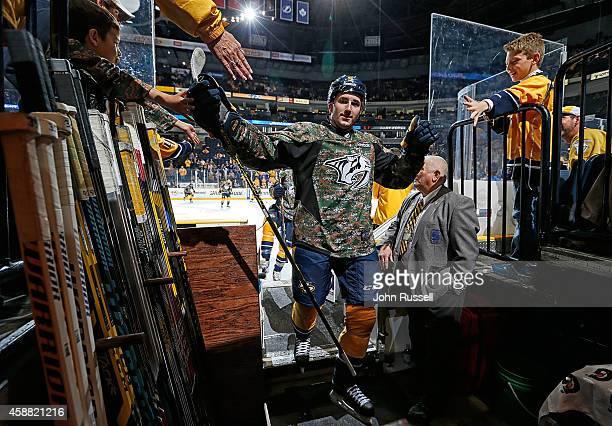 Filip Forsberg of the Nashville Predators wears a camouflage jersey for warmups against the Edmonton Oilers in honor of Veterans Day at Bridgestone...