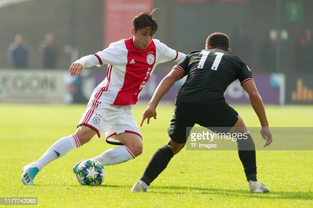 Filip Frei of Ajax Amsterdam U19 and Henry Lawrence of FC Chelsea U19 battle for the ball during the UEFA Youth League match between AFC Ajax and...