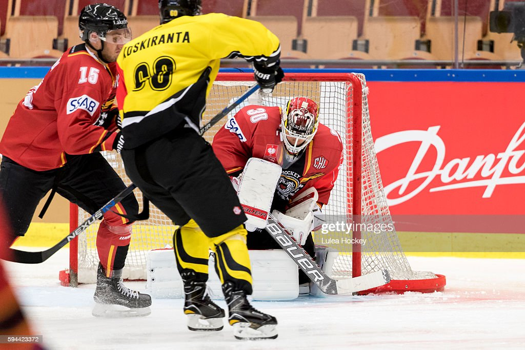 Filip Gustafsson #30 Goaltender of Lulea Hockey blocking the puck in front of Tero Koskiranta #60 of SaiPa Lappeenranta during the Champions Hockey League match between Lulea Hockey and SaiPa Lappeenranta at Coop Norrbotten Arena on August 23, 2016 in Lulea, Sweden.