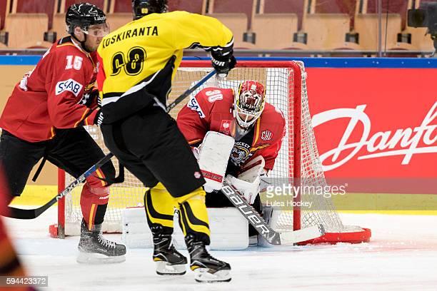 Filip Gustafsson Goaltender of Lulea Hockey blocking the puck in front of Tero Koskiranta of SaiPa Lappeenranta during the Champions Hockey League...
