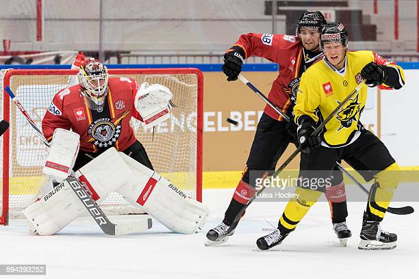 Filip Gustafsson Goaltender of Lulea Hockey see the puck come when Pontus Sjalin of Lulea Hockey takes out the opponent during the Champions Hockey...