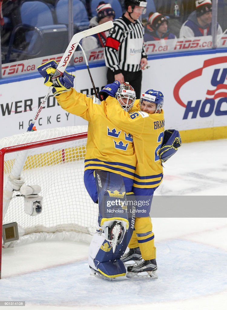Filip Gustavsson #30 and Erik Brännström #26 of Sweden celebrate team Sweden's 4-2 victory over the United States in the IIHF World Junior Championships Semifinal game at KeyBank Center on January 4, 2018 in Buffalo, New York.