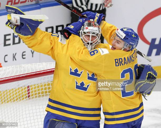 Filip Gustavsson of Sweden and Erik Brännström celebrate Sweden's 42 victory over the United States following the third period of play in the IIHF...
