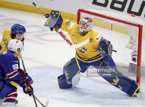Filip Gustavsson of Sweden makes a save against the United States during the first period of play in the IIHF World Junior Championships Semifinal...