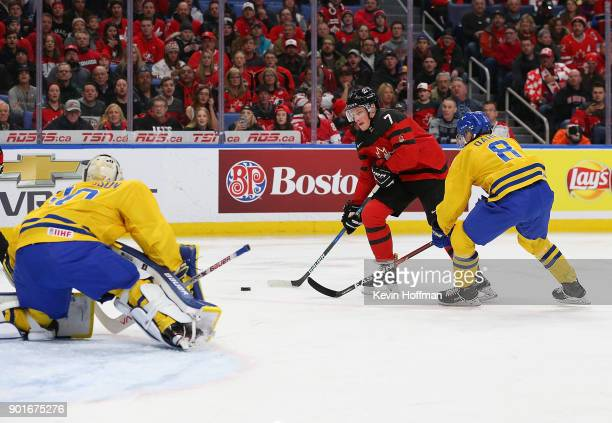 Filip Gustavsson of Sweden makes the save against Cale Makar as Rasmus Dahlin defends during the Gold medal game of the IIHF World Junior...