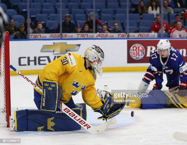 Filip Gustavsson of Sweden makes the save as Kailer Yamamoto of United States looks on in the second period during the IIHF World Junior Championship...
