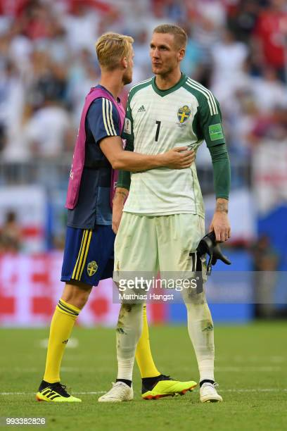 Filip Helander consoles Victor Lindelof of Sweden following the 2018 FIFA World Cup Russia Quarter Final match between Sweden and England at Samara...