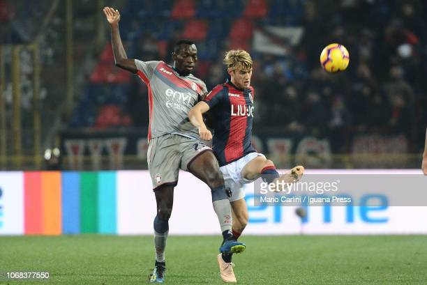 Filip Helander of Bologna FC competes for the ball with Sauli Väisänen of Crotone FC during the Coppa Italia match between Bologna FC and Crotone FC...