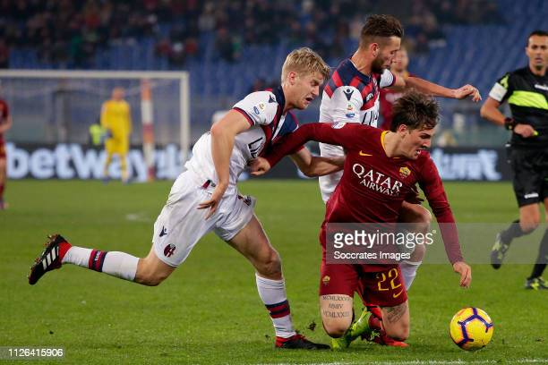 Filip Helander of Bologna FC Nicolo Zaniolo of AS Roma Mitchell Dijks of Bologna FC during the Italian Serie A match between AS Roma v Bologna at the...