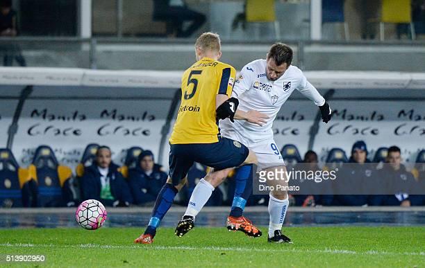 Filip Helander of Hellas Verona competes with Antonio Cassano of UC Sampdoria during the Serie A match between Hellas Verona FC and UC Sampdoria at...