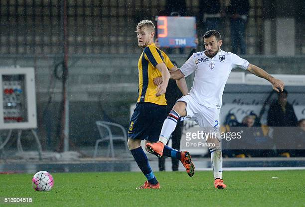 Filip Helander of Hellas Verona competes with Fabio Quagliarella of UC Sampdoria during the Serie A match between Hellas Verona FC and UC Sampdoria...