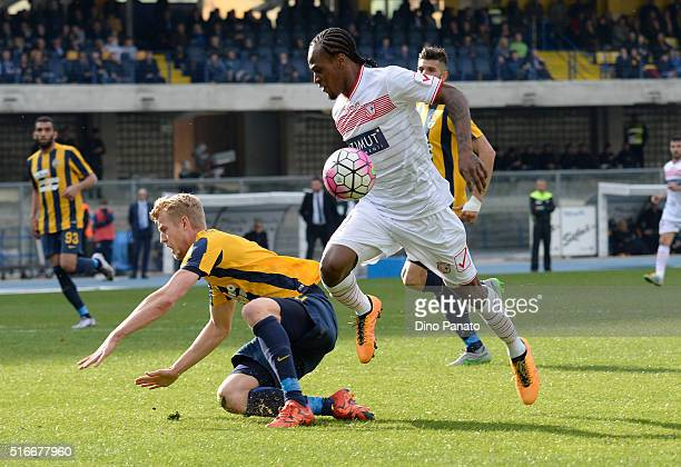 Filip Helander of Hellas Verona competes with Jerry Mbakogu of Carpi FC during the Serie A match between Hellas Verona FC and Carpi FC at Stadio...