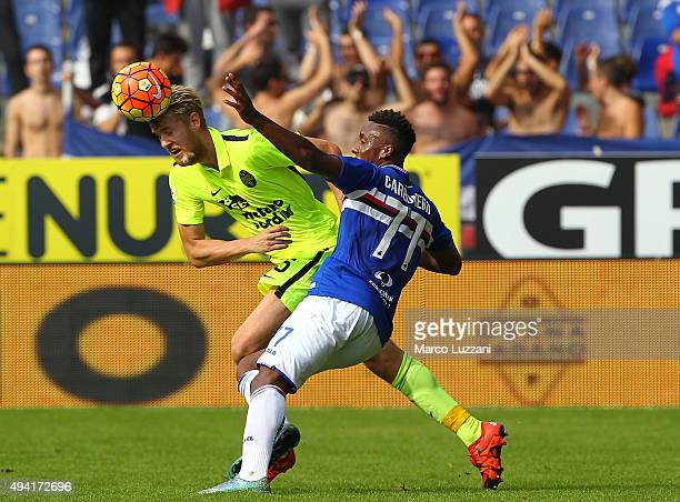 Filip Helander of Hellas Verona FC competes for the ball with Carlos Mario Carbonero of UC Sampdoria during the Serie A match between UC Sampdoria...