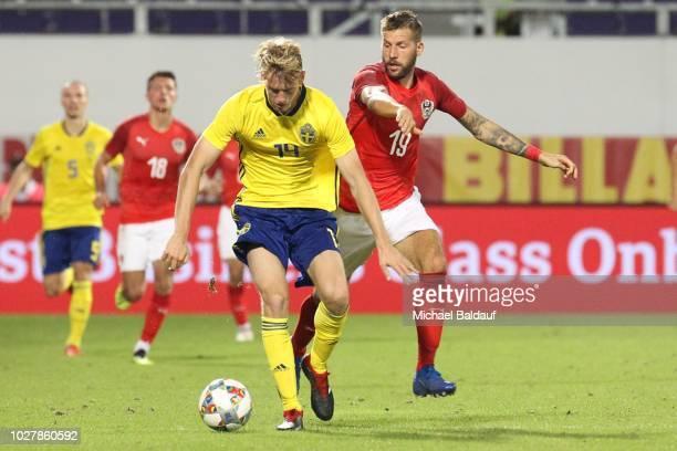 Filip Helander of Sweden and Guido Burgstaller of Austria during the internationl friendly match between Austria and Sweden at Generali Arena on...