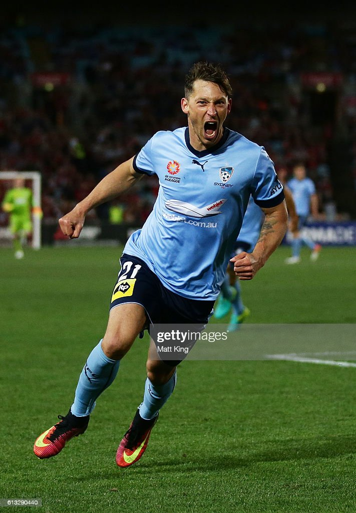 Filip Holosko of Sydney FC celebrates scoring the first goal during the round one A-League match between the Western Sydney Wanderers and Sydney FC at ANZ Stadium on October 8, 2016 in Sydney, Australia.