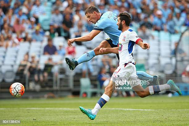 Filip Holosko of Sydney FC scores a goal under pressure from Nicholas Cowburn of the Jets during the round 14 ALeague match between Sydney FC and the...