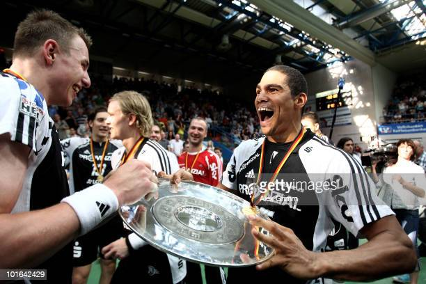 Filip Jicha and Daniel Narcisse of Kiel celebrate after the Toyota Handball Bundesliga match between TV Grosswallstadt and THW Kiel at the...
