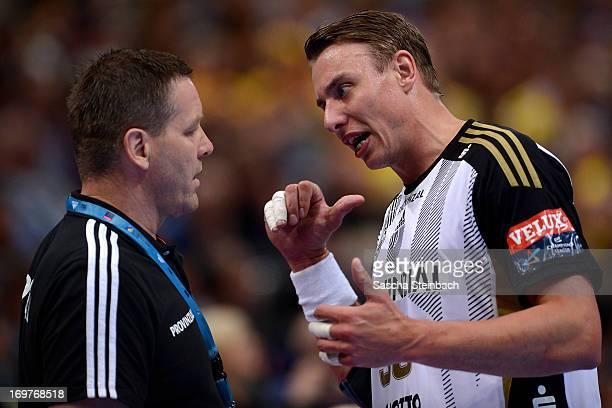 Filip Jicha gets instructions from Head coach Alfred Gislason of Kiel during the EHF Final Four match between THW Kiel and HSV Hamburg at Lanxess...