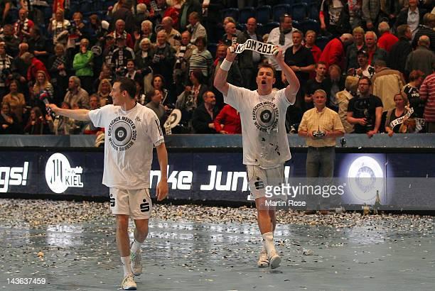 Filip Jicha of Kiel celebrate with team mate Dominik Klein after winning the Toyota Handball Bundesliga match between THW Kiel and SC Magdeburg at...