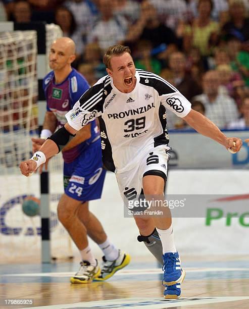 Filip Jicha of Kiel celebrates during the DKB Handball Budesliga mtach between HSV Hamburg and THW Kiel at the O2 world on September 7 2013 in...