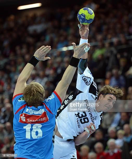 Filip Jicha of Kiel challenges for the ball with Frej Gustav Rydergard of Hannover during the HBL Bundesliga game between THW Kiel and TSV...