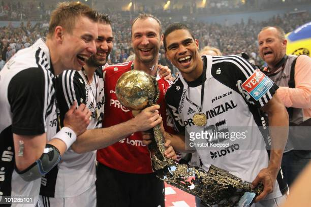 Filip Jicha of Kiel Ihor Anic Thierry Omeyer and Daniel Narcisse present the handball champions league trophy after winning 3634 the handball final...