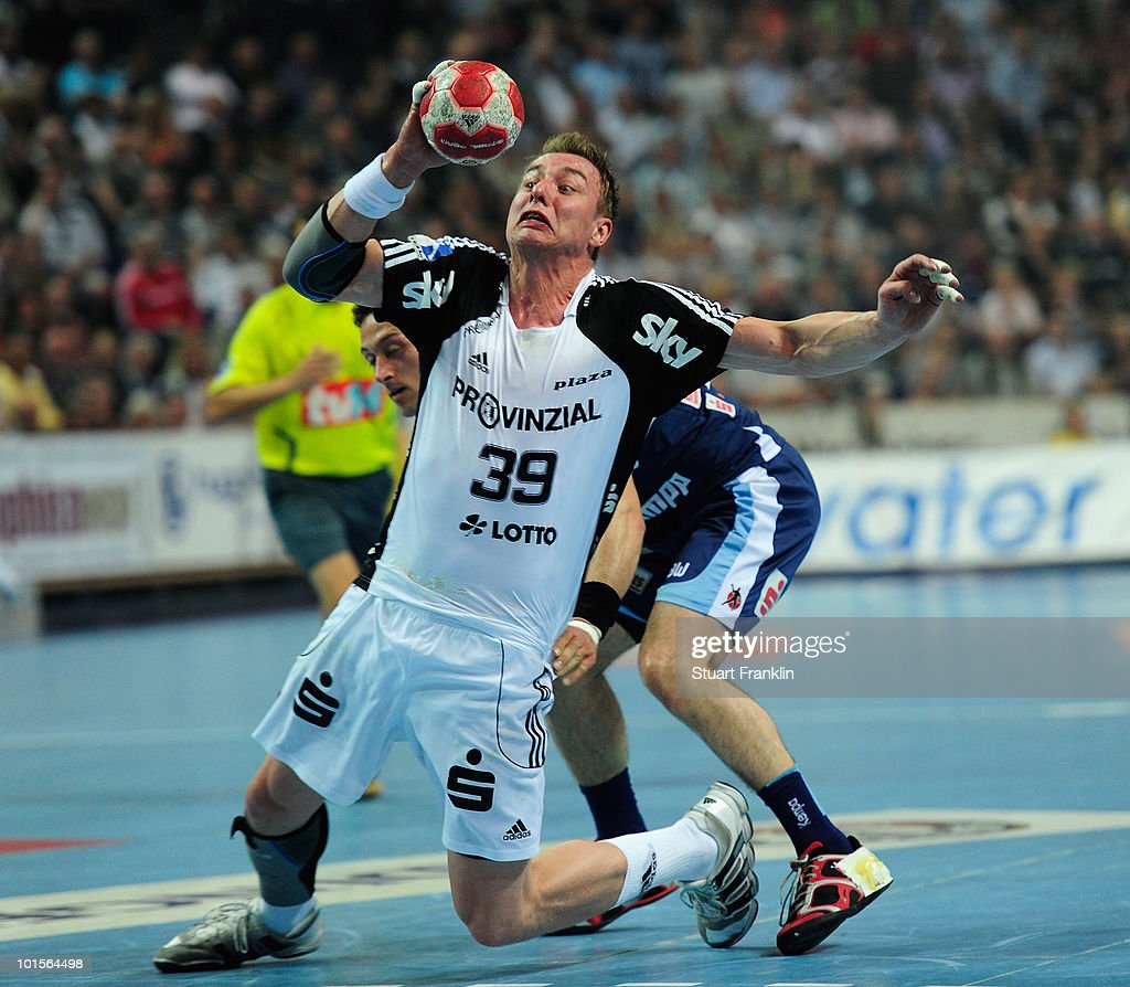 Filip Jicha of Kiel is challenged by Vladimir Temelkov of Balingen during the Toyota Handball bundesliga match between THW Kiel and HBW Balingen-Weilstetten at the Sparkassen Arena on June 2, 2010 in Kiel, Germany.