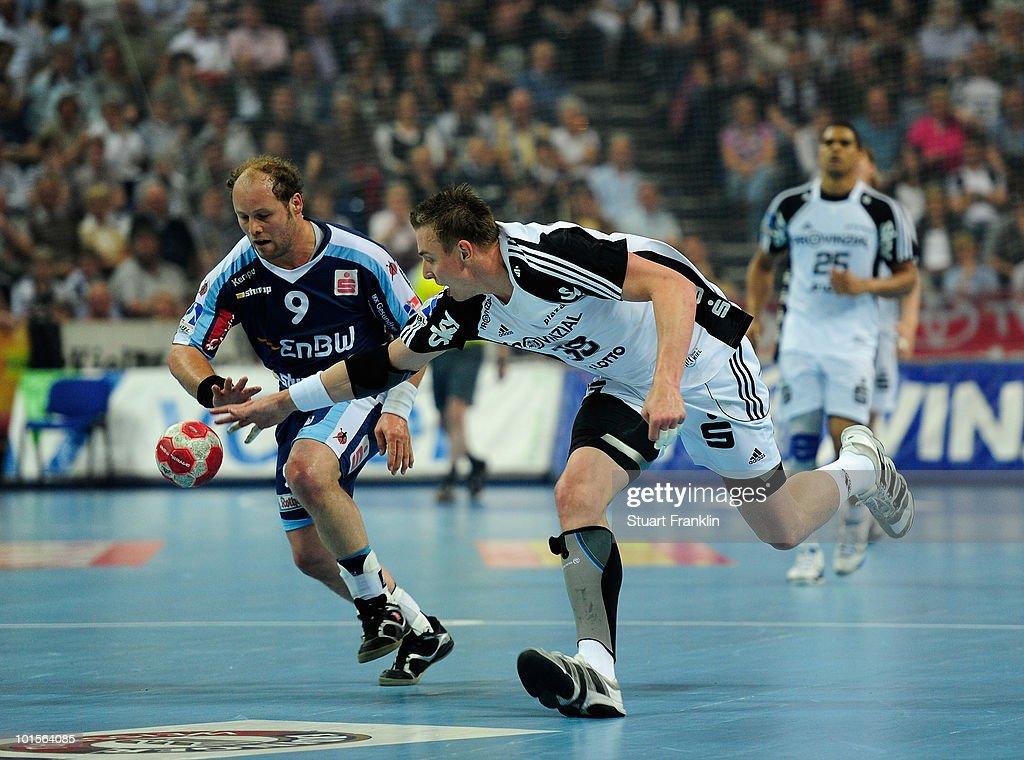 Filip Jicha of Kiel is challenged byFrank Ettwein of Balingen during the Toyota Handball bundesliga match between THW Kiel and HBW Balingen-Weilstetten at the Sparkassen Arena on June 2, 2010 in Kiel, Germany.