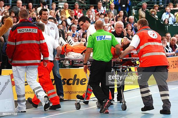 Filip Jicha of Kiel receives medical treatment during the Handball Bundesliga match between TBV Lemgo and THW Kiel at the Gerry Weber Stadium on...