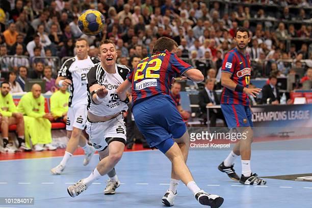 Filip Jicha of Kiel thorws a ball against Shiarei Rutenka of Barcelona Borges during the handball final match between THW Kiel and FC Barcelona...