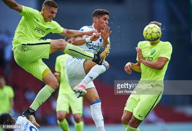 Filip Kasa of MSK Zilina and Pieros Sotiriou of FC Copenhagen compete for the ball during the UEFA Champions League Qualification match between FC...