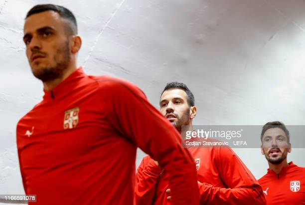 Filip Kostic Luka Milivojevic and Filip Mladenovic of Serbia enter the pitch prior to the UEFA Euro 2020 qualifier between Serbia and Portugal at...