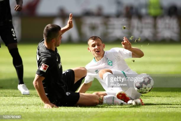 Filip Kostic of Eintracht Frankfurt and Maximilian Eggestein of Werder Bremen battles for possession during the Bundesliga match between Eintracht...