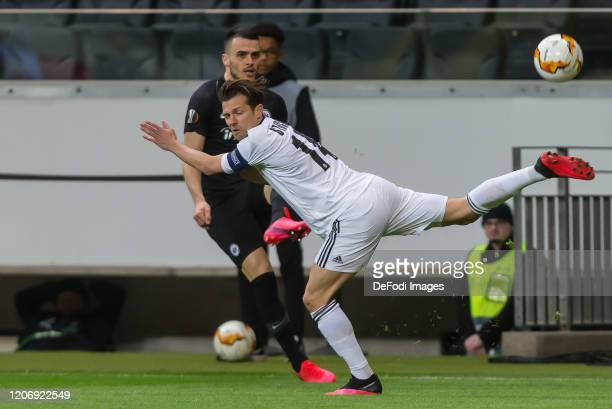 Filip Kostic of Eintracht Frankfurt and Valentin Stocker of FC Basel 1893 battle for the ball during the UEFA Europa League round of 16 first leg...