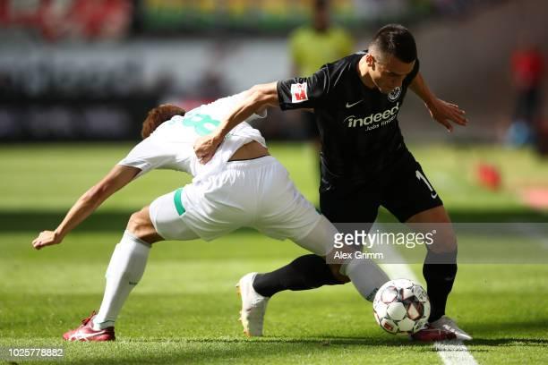 Filip Kostic of Eintracht Frankfurt and Yuya Osako of Werder Bremen battle for possession during the Bundesliga match between Eintracht Frankfurt and...