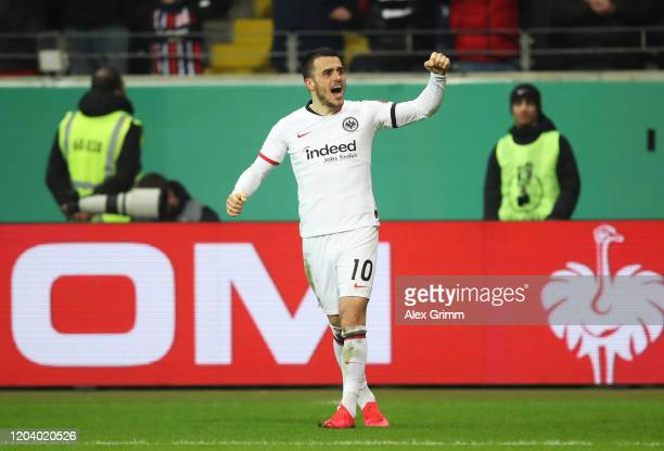 Filip Kostic of Eintracht Frankfurt celebrates after scoring his team's second goal during the DFB Cup round of sixteen match between Eintracht...