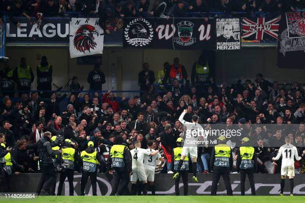 Filip Kostic of Eintracht Frankfurt celebrates with fans and teammates after Luka Jovic of Eintracht Frankfurt scores his team's first goal during...