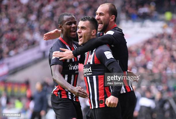 Filip Kostic of Eintracht Frankfurt celebrates with teammates after scoring his team's first goal during the Bundesliga match between Eintracht...