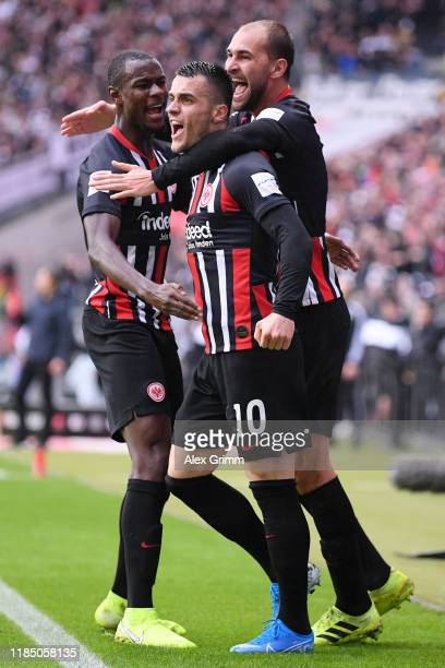 Filip Kostic of Eintracht Frankfurt celebrates with teammates after scoring his team's first goal during the Bundesliga match between Eintracht...