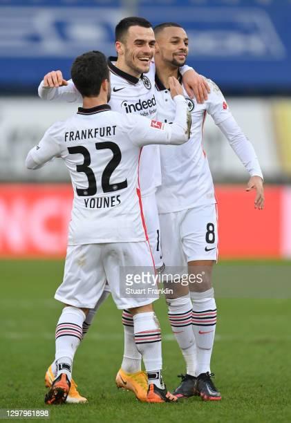 Filip Kostic of Eintracht Frankfurt celebrates with teammates Amin Younes and Djibril Sow of Eintracht Frankfurt after scoring their team's second...