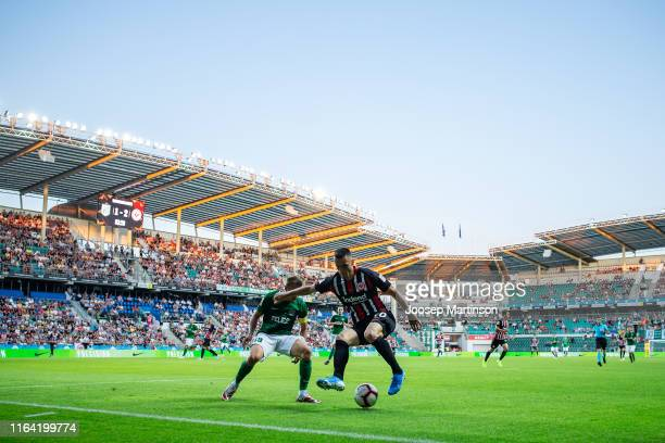 Filip Kostic of Eintracht Frankfurt competes with Gert Kams of FC Flora Tallinn during the UEFA Europa League Second Qualifying Round 1st Leg match...