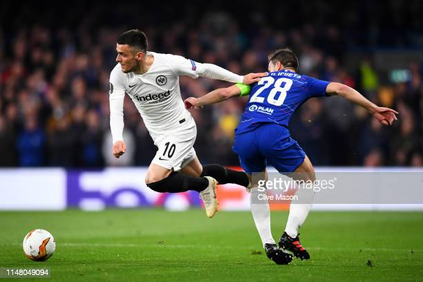 Filip Kostic of Eintracht Frankfurt evades Cesar Azpilicueta of Chelsea during the UEFA Europa League Semi Final Second Leg match between Chelsea and...